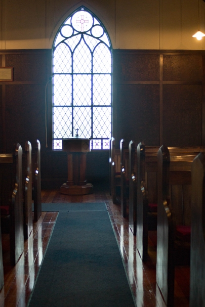 St David's interior - looking down aisle towards stained glass window